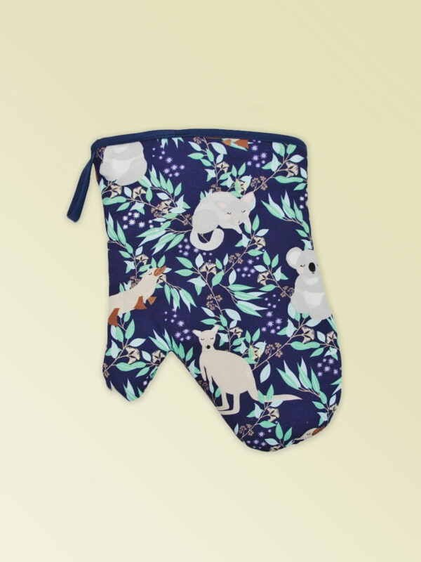 Insulated single oven mitt with an Aussie flora pattern on the fabric and a dark navy edging.