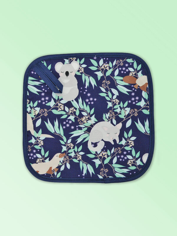 Insulated pot holder with an Aussie Animals pattern on the fabric and a dark navy edging with a hang tab.