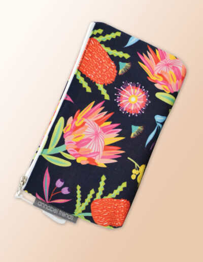 Small water resistant cosmetic bag with an Aussie Flora pattern on it and a zip closure.