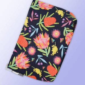 Large water resistant cosmetic bag with an Aussie Flora pattern on it and a zip closure.