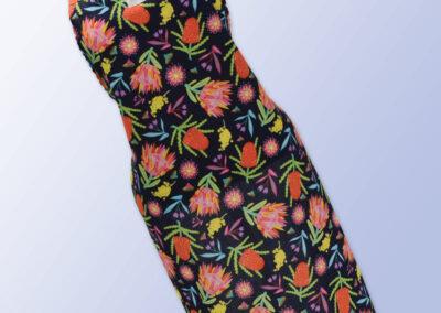 Fabric kitchen apron, dark navy with Aussie Flora print on it