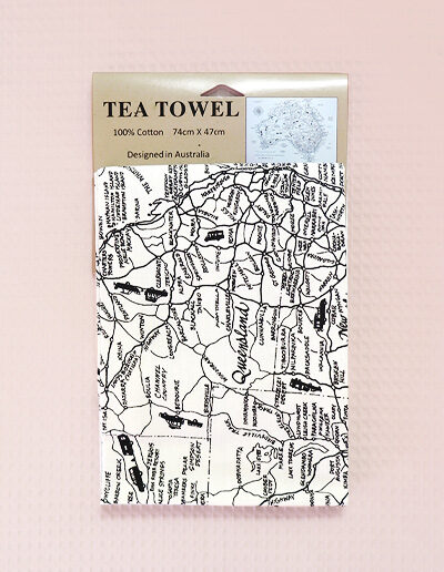 A white cotton tea towel with a detailed Australian map on it.
