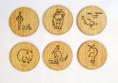 Set of six wooden coasters. Each coaster is a different animal. They are Emu, Koala, Wombat, Platypus, Kangaroo and Possum