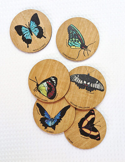 Set of six wooden coasters. Each coaster is a different coloured butterfly.