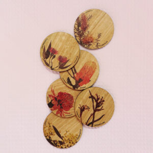 Set of six wooden coasters. Each coaster is a different coloured native flower of Australia.