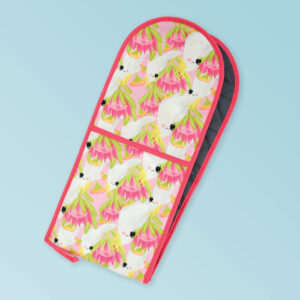 Insulated double oven mitts with a pink cockatoo pattern on the fabric and a dark pink edging..