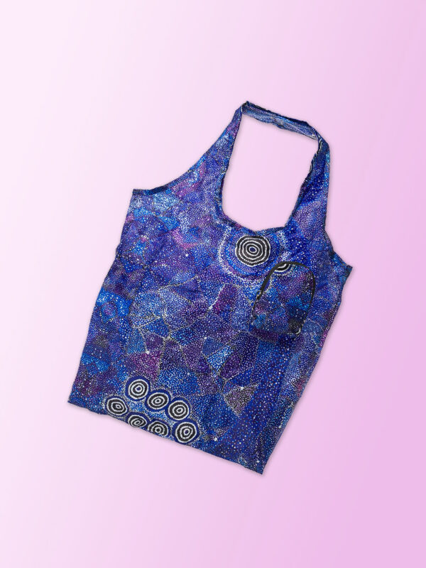 Foldable shopping tote featuring Alma Granites artwork