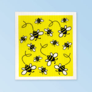 White dishcloth with a cute bee design on it