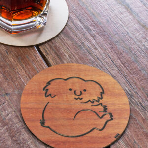 Wooden Koala round coaster on a table
