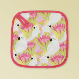 Insulated pot holder with a pink cockatoo pattern on the fabric and a dark pink edging with a hang tab.