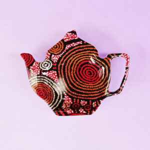Melamine tea bag holder in the shape of a teapot. The pattern on it is artwork by Teddy Gibson.
