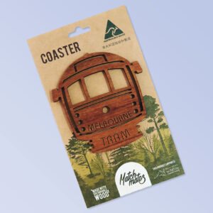 A wooden Melbourne Tram shape coaster on a recycled card for presentation