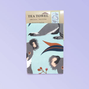 A light blue cotton tea towel with Koala images printed on it.