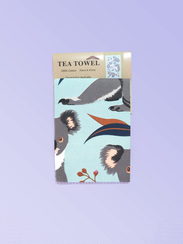 A light blue cotton tea towel with Koala images printed on it.