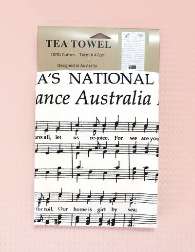 A white cotton tea towel with Australia's National Anthem in words and music on it.