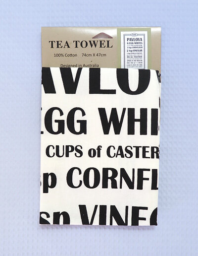 A white cotton tea towel with a Pavlova recipe printed in black on it.