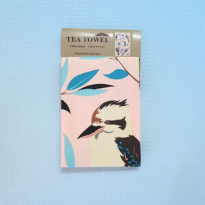 A light pink cotton tea towel with Kookaburra images printed on it.