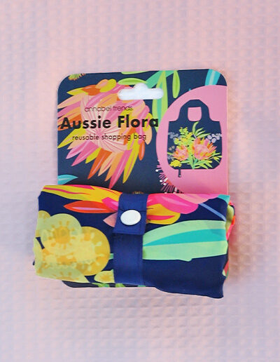 Foldable strong shopping bag printed with illustrations of Australian icons. Made with polyester. This image shows how small it folds.