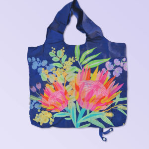 Foldable strong shopping bag printed with illustrations of Australian flora. It has a navy background. Made with polyester.