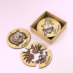 Wooden Australian Animal jigsaw puzzle set. A set of 6 different three piece animal jigsaws. Each is a round shape. They are packaged in a recycled cardboard presentation box