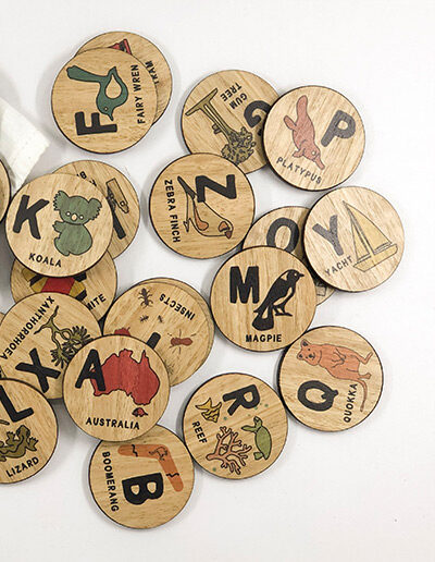 Wooden Australian Alphabet discs. 26 round wooden discs every letter of the alphabet and an image to go with that letter. e.g N is Ned Kelly.