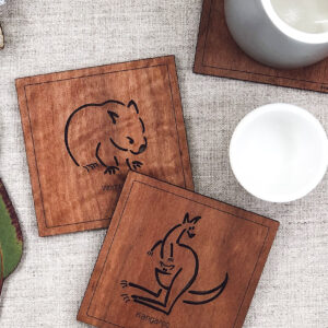 Set of six wooden square coasters and their recycled cardboard presentation box. Each coaster is a different animal. They are Emu, Koala, Wombat, Platypus, Kangaroo and Possum