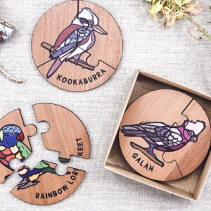 Wooden bird jigsaw puzzle set. A set of 6 different three piece bird jigsaws. Each is a round shape. They are packaged in a recycled cardboard presentation box
