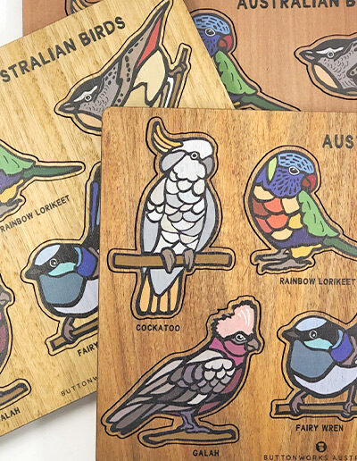 A wooden bird puzzle. Rectangular in shape with 6 different colourful bird shapes to place back in the correct cut out shape.