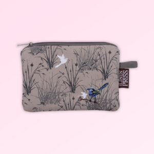 Fabric large purse with zip closure with an embroidered pair of blue wrens perched in grasses. The fabric is a natural Australian organic cotton.