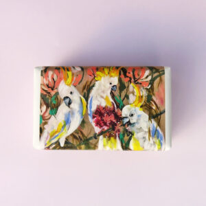 Bar of soap wrapped in paper with a Cockatoo design.