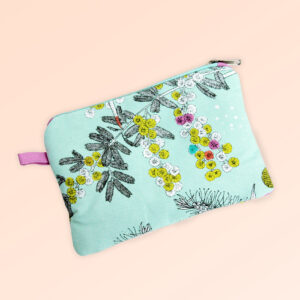 Fabric purse with zip closure. The fabric is Australian organic cotton with an aqua background and budgerigars and small native flowers in pastel colours