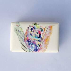 Bar of soap wrapped in paper with a Koala in a tree design.