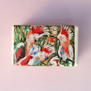 Bar of soap wrapped in paper with a Major Mitchell bird design.