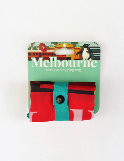 Foldable strong shopping bag printed with illustrations of Melbourne icons. Made with polyester. This image shows how small it folds.