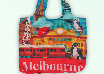 Foldable strong shopping bag printed with illustrations of Melbourne icons. Made with polyester.
