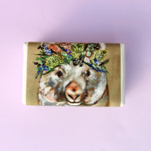 Bar of soap wrapped in paper with a Wombat design.