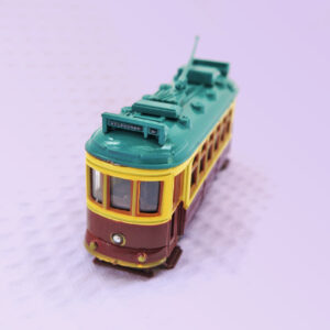 A metal model of a City Circle tram in the maroon colour.