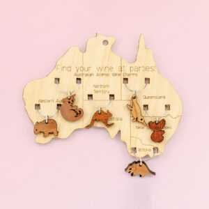 Wooden map of Australia which presents on it 6 wine glass charms of six different animals. One is attached to the map in each state.