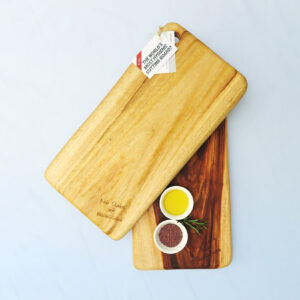 Two medium wooden chopping boards with a dish of salt & a dish of oil