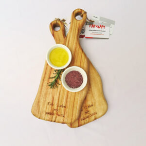 Two small paddle chopping boards with a dish of salt & a dish of oil