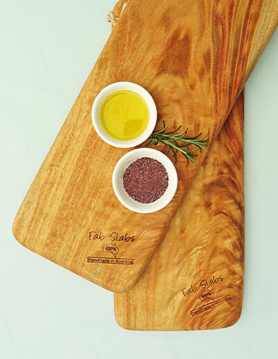 Two small chopping boards with a dish of salt & a dish of oil