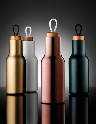 Four assorted coloured 600ml Tempa drink bottles