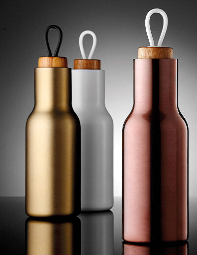 Three assorted coloured 600ml Tempa drink bottles