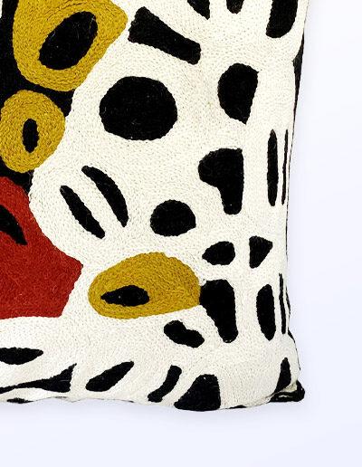 Detail of Better World Arts Wool cushion 40cm. Design by Anmanari Brown