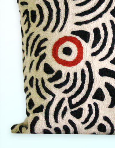 Detail of Better World Arts Wool cushion 30cm. Design by Nelly Patterson