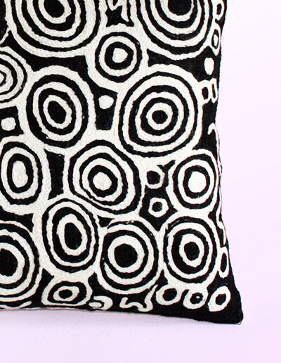 Detail of Better World Arts Wool cushion 40cm. Design by Nelly Patterson