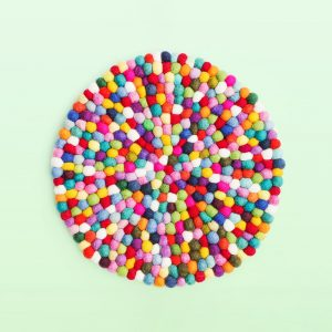 Large colourful felt ball trivet